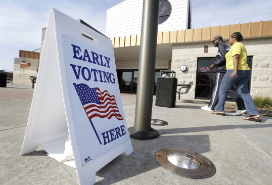 Voters arrive to cast early ballots in Davenport, Iowa. (Charlie Neibergall, AP)